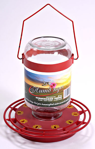 Item # - 40oz Easy fill glass container Guaranteed not to drip. Designed to feed ONLY hummingbirds. Red ABS Plastic base (non-metallic) Full ring perch with 10 feeding stations with metal hanger. Case Qty:6